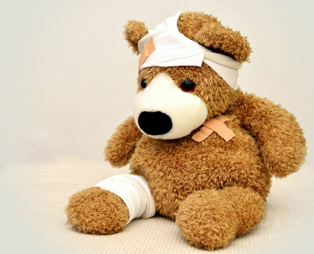 Bear toy with a bandage on